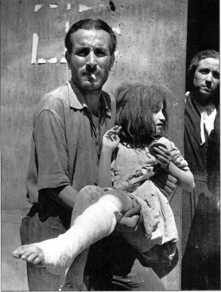 Photography by Robert Capa©International Center of Photography/Magnum - Collection of the Hungarian National Museum: Man carrying girl with bandaged leg, Troina, 6 agosto 1943.